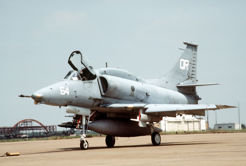 A left front view of a Marine Attack Squadron 322 (VMA-332) A-4M Skyhawk aircraft parked on the flight line.