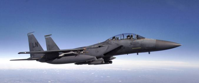 Capt. Timothy Morris, in rear, and Maj. Stephen Damico fly their F-15E Strike Eagle during a training flight from Royal Air Force Lakenheath, England, on Thursday, Aug. 3. The jet, of the 492nd Fighter Squadron ÒMadhatters,Ó was part of three-ship formation that flew to an area off the southwestern coast of England to practice surface attack training techniques. This training mission enhances aircrewÕs air strike skills without the need to drop bombs or shoot their 20 mm cannon. Captain Morris, a weapons systems officer, is from Bohemia, N.Y. Pilot Major Damico is from Greenville, S.C. (U.S. Air Force photo/Master Sgt. Lance Cheung)